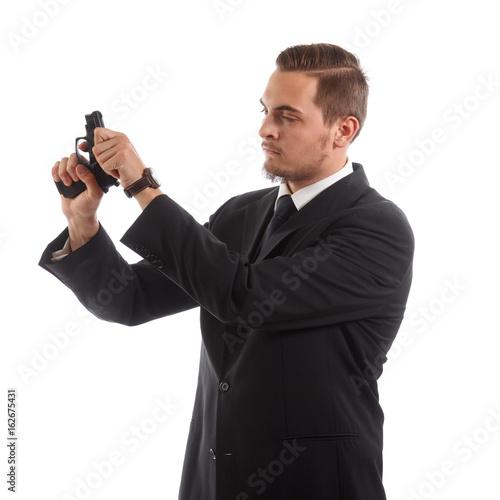 Fototapety, obrazy: Man preparing a gun