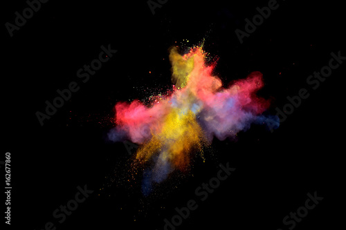 Bizarre forms of multi color powder paint and flour combined  exploding in front of a black background to give off fantastic colors and forms Canvas-taulu
