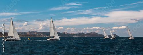 Panorama of sailing regatta in the Aegean Sea. Luxury leisure and sports.