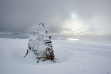 Ice Covered Cairn At Summit Of...
