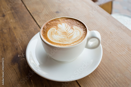 Fototapety, obrazy: Coffee cup with milk on the table