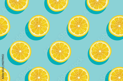 Papel de parede Slices of fresh yellow lemon summer background.