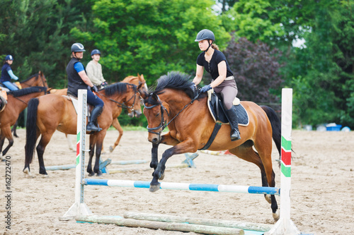Poster Equitation Horse rider is training in the arena