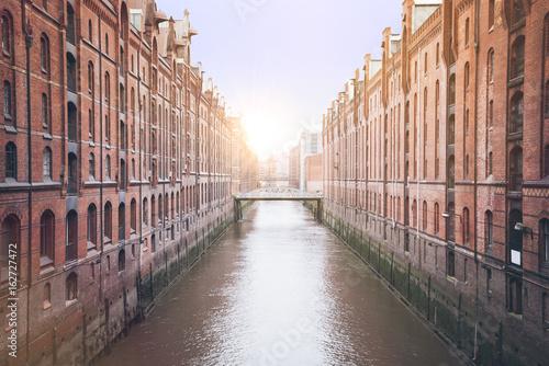 Fotografía  channel in the old warehouse district Speicherstadt in Hamburg, Germany under bl