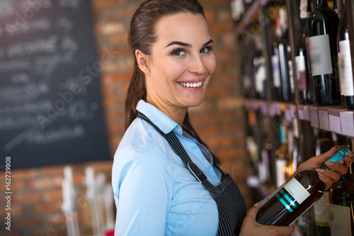 Woman working in wine shop