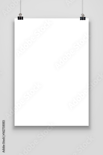 Blank paper poster mockup isolated on a gray background. Canvas Print