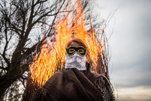 Woman In Front Of A Huge Fire During Buso Festivities