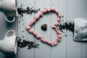 A white mug with pink heart