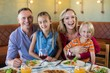 canvas print picture - Portrait of cheerful family at restaurant