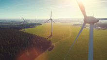 Windmill At Windfarm On A Sunn...