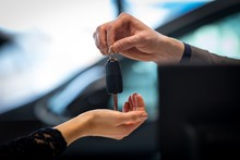 Cropped Image Of Salesman Giving Car Key To Customer