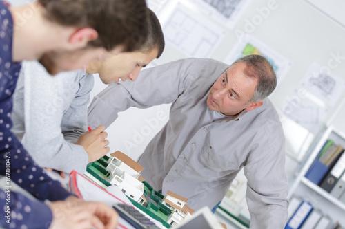 Fotografie, Obraz  Man reprimanding younger worker