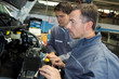 car mechanic and assistant in garage