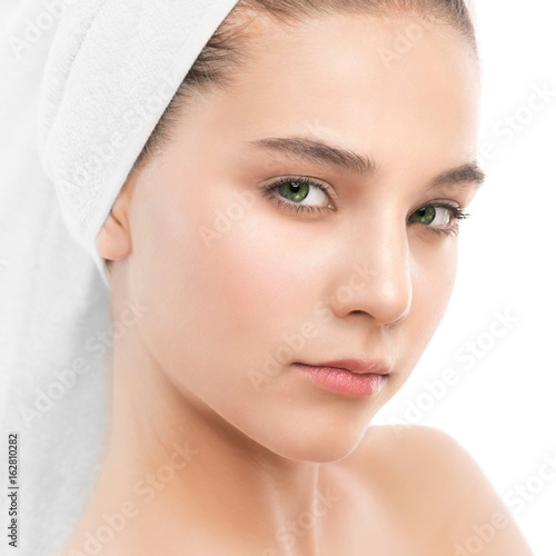 Fotografie, Tablou  Beautiful young brunette woman with clean face and towel on her head