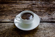 A cup of coffee on a wooden background