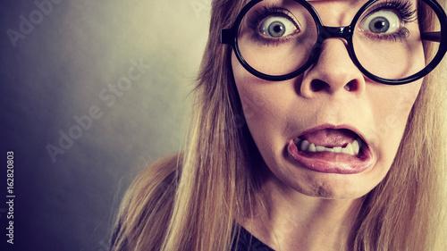 Fotografie, Tablou Closeup woman shocked face with eyeglasses