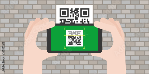 Valokuvatapetti Hand holding smart phone scanning qr code on the old wall, flat design vector fo