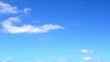 Time lapse of white clouds in the blue sky