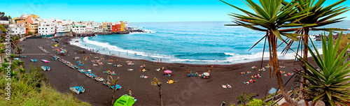 Photo Stands Light blue Playas de España.Paisaje pintoresco de playa y casas.Tenerife.Islas Canarias