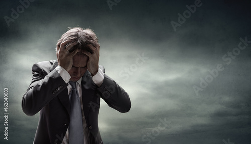 Fotografía  Depressed Businessman With Grunge Cloudscape