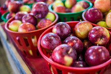 Macro Closeup Of Many Red Apples In Farmers Market In Baskets On Display
