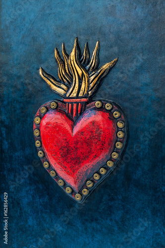 Red sacred heart on blue background Fototapete