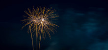 Orange Fireworks Blue Background