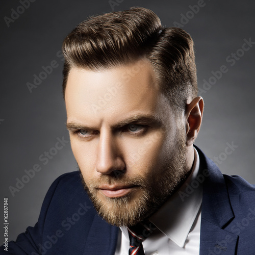 Handsome Young Man With Perfect Hair Style Over Dark Background