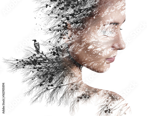 Double exposure portrait of young woman and pine with black crow. Wall mural