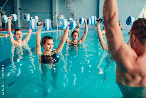women-aqua-aerobics-traninig-with-dumbbells