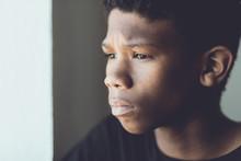Faded Retro Portrait Of A Worried African Boy
