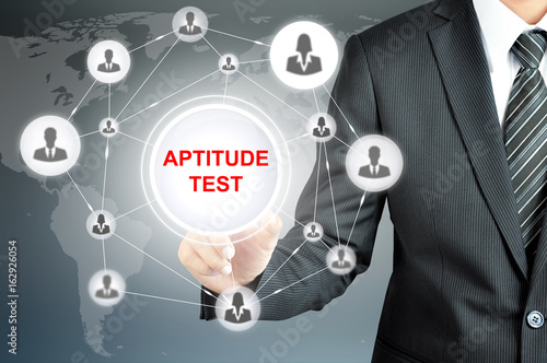 Photo Businessman hands touching APTITUDE TEST sign on virtual screen