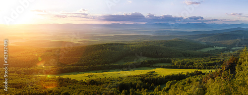 Foto auf Gartenposter Hugel Aerial panorama view of greenery hills and meadow at sunrise in Ural, Russia