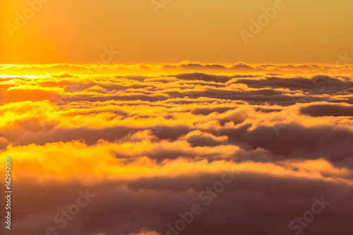 Sunset above the clouds Wallpaper Mural
