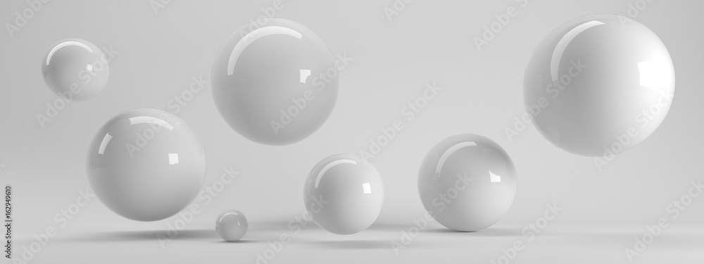 Fototapety, obrazy: 3d rendering of several sized reflected spheres inside a white studio