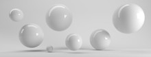 3d Rendering Of Several Sized Reflected Spheres Inside A White Studio