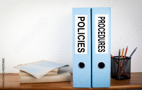 Valokuva  Policies and Procedures binders in the office