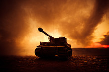 War Concept. Military Silhouettes Fighting Scene On War Fog Sky Background, World War German Tanks Silhouettes Below Cloudy Skyline At Night. Attack Scene. Armored Vehicles. Tanks Battle Scene