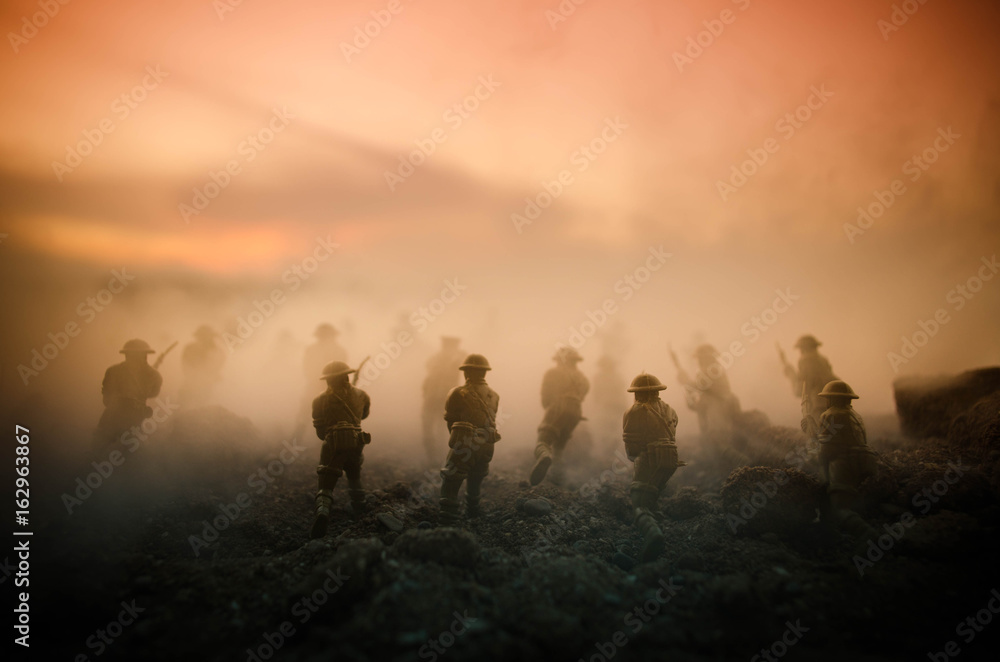 Fototapeta War Concept. Military silhouettes fighting scene on war fog sky background, World War Soldiers Silhouettes Below Cloudy Skyline At night. Attack scene. Armored vehicles. Tanks battle