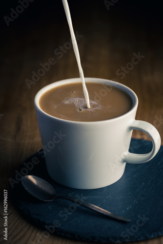 Wall Murals Cafe Coffee cup with milk
