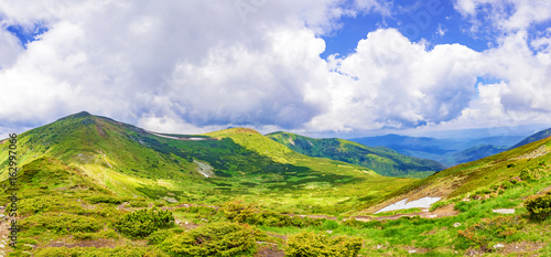 Fototapety, obrazy: Panoramic view of the sky and mountain ridges from the top of the mountain in a sunny summer day