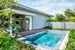 Tropical beach resort. Swimming pool near living room