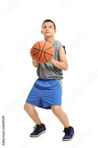 Boy about to throw a basketball