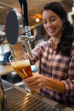 Pretty Barmaid Pouring Beer Fr...