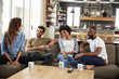 canvas print picture - Couple Sitting On Sofa With Friends At Home Talking