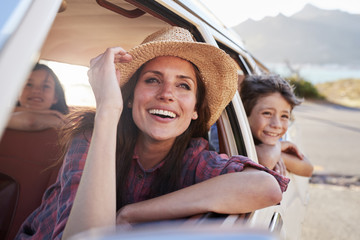 Mother And Children Relaxing In Car During Road Trip