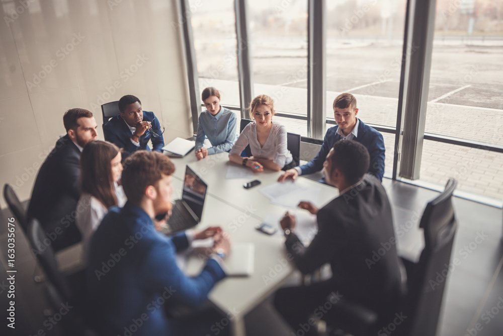 Fototapeta Corporate business team and manager in a meeting