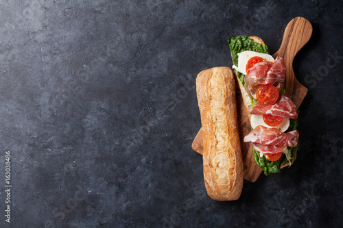 Sandwich with salad, prosciutto and mozzarella