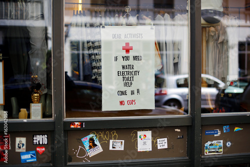 A shop window with a G20 protest slogan is pictured in the Karolinen