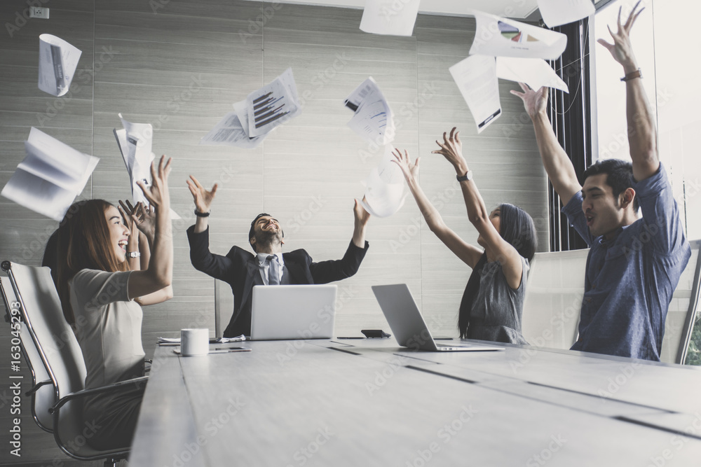 Fototapeta business team throwing paper when meeting success with happy emotion together, people with successful concept,